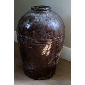 Oude olijfkruik